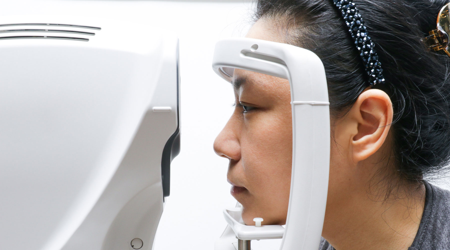 An individual has their eye scanned in a machine