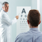 Patient looking at a letter chart during eye exam