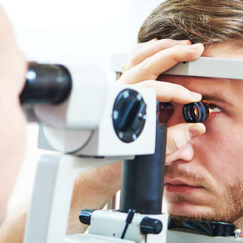 Man being checked for glaucoma in an eye doctor office