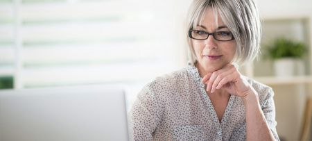 Woman With Glasses Thinking About Making An Eye Appointment